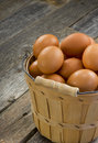 Basket fresh wooden eggs old wooden floor background Royalty Free Stock Images