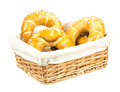 Basket with freshly baken sweet buns full of Stock Photos