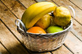 Basket of fruits still life shot a white on wooden rustic table Royalty Free Stock Images