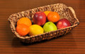Basket with fruits on the table Royalty Free Stock Image