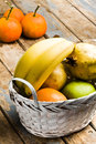 Basket of fruits on wooden table still life shot a white rustic Royalty Free Stock Photography