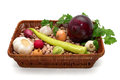 A basket full of beans, onion, garlic with green peppers, radishes, cabbage and parsley Royalty Free Stock Photo
