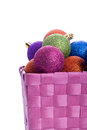 Basket full of colorful christmas balls Royalty Free Stock Image