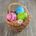 Basket full of easter eggs colourful in a nest Stock Photo