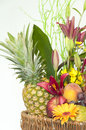 Basket full of fruits and flowers wicker on a white background Royalty Free Stock Images