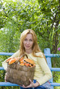 Basket, full mushrooms, and young woman-mushroom p Royalty Free Stock Image