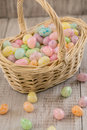 Basket full of pastel colored Easter egg candy