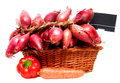 Basket full of red onions and price tag isolated on white background Stock Photo