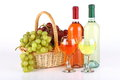 Basket with grapes and wine bottles of full of on white background Stock Image