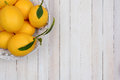 Basket of lemons in corner high angle shot a fresh picked the the frame horizontal format with copy space Stock Photos