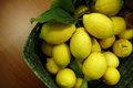 Basket of lemons on the table Stock Images