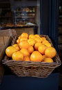 Basket of oranges Stock Photos