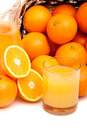 Basket of oranges and juice in a galss Royalty Free Stock Photo