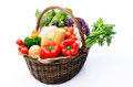 Basket of organic fresh produce from farmers market full summer organicc vegetables the tomatoes peppers capsicums celery cabbage Royalty Free Stock Image