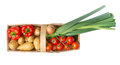 Basket with organic vegetable on white background Royalty Free Stock Photos