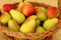 Basket with pears and apples basketwork bin filled Royalty Free Stock Photography