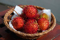 Basket of rambutan a tropical fruit Stock Photo