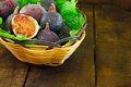 Basket of ripe figs Stock Photos