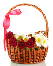 A basket of roses and daisies  close-up Royalty Free Stock Photos