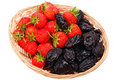 Basket with strawberry and prune on white Royalty Free Stock Photos