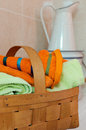 Basket for towels and white ewer Stock Photography