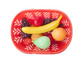 Basket with toy fruits on white Stock Images
