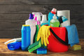 Basket with variety cleaning product on wooden table Royalty Free Stock Photo