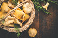Basket with wild mushrooms chanterelles closeup on a dark background Royalty Free Stock Photo