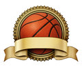 Basketball award crest on a gold medallion for competition tournaments with a blank area ribbon for copy space as a symbol of Stock Image