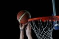 Basketball ball and net on grey background board in gym indoor Royalty Free Stock Photography