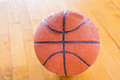 Basketball ball over floor in the gym Stock Photos
