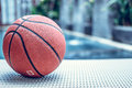 stock image of  Basketball ball on a swimming pool background, tropical sport scene.