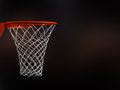 Basketball basket in arena with white nets on black background Stock Images