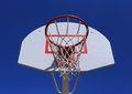 Basketball basket on blue sky background.  durable mesh. Royalty Free Stock Photo