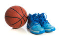 Basketball with blue basketball shoes on white Royalty Free Stock Photo