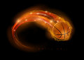 Basketball comet ball in flames and lights against black background vector illustration Royalty Free Stock Photo