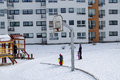 Basketball court winter small children nannies vilnius lithuania february childrens backyard in the with on february in vilnius Royalty Free Stock Images