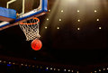 Basketball game a ball swishes through the net at a in a professional arena Stock Photography