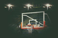 Basketball going through net and scoring during match ,Blurry an Royalty Free Stock Photo