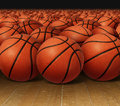 Basketball group on a hardwood court floor as an infinite background for sports and fitness symbol of a team leisure activity Royalty Free Stock Image