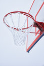 Basketball hoop with net, covered by hoarfrost Royalty Free Stock Photo