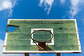 Basketball hoop old and deteriorate on blue sky with cloud Royalty Free Stock Photography