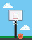 Basketball hoop outside with sky background Royalty Free Stock Photo