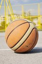 Basketball iluminating by sunlight Stock Photos