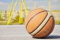 Basketball iluminating by sunlight Royalty Free Stock Image