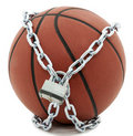 Basketball with Padlock And Chain Royalty Free Stock Photo