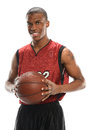 Basketball payer holding ball young african american player isolated over white background Stock Image