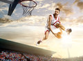 Basketball player in action on background of sky and crowd Stock Photos