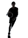 Basketball player dribbling silhouette Royalty Free Stock Photo