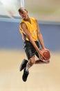 Basketball Player Dunking Ball Royalty Free Stock Photo
